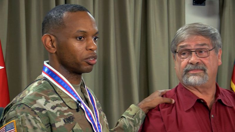 Sgt. First Class Mario King, left, saved driver Burl Doug Bowling, right, from an overturned...