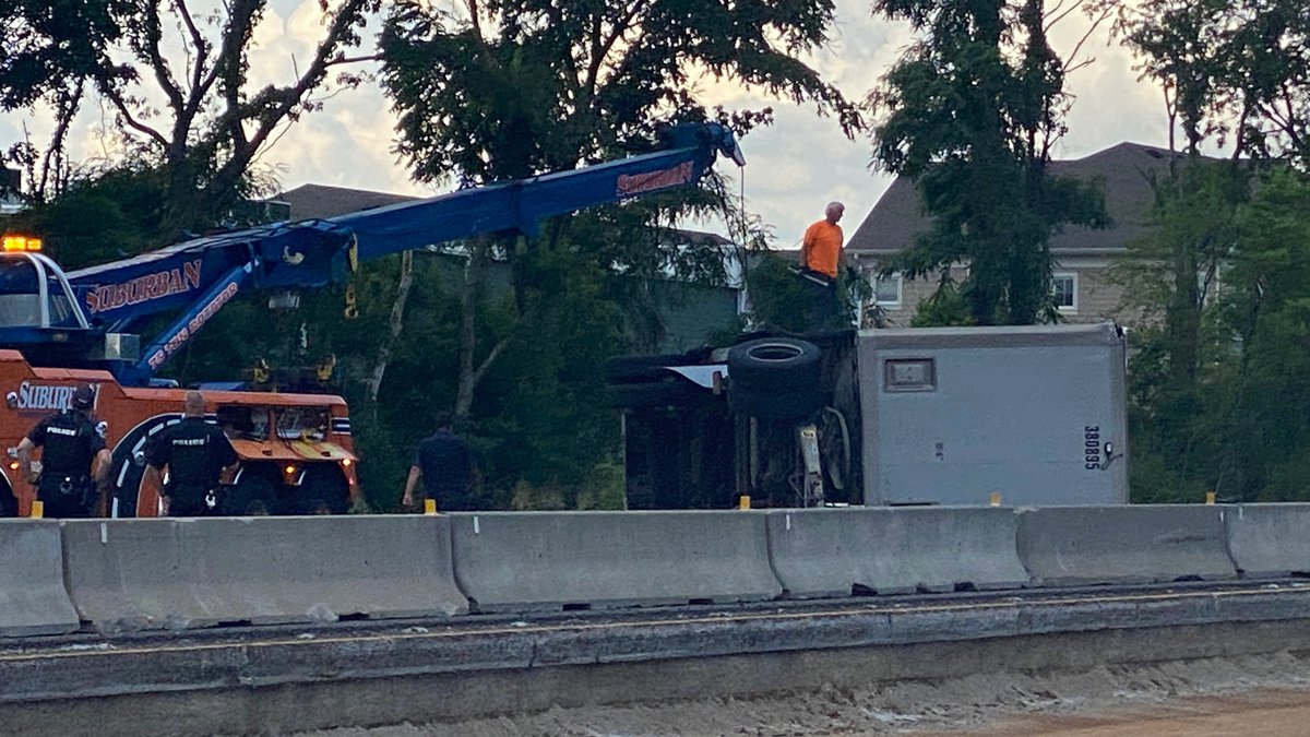 An overturned semi-truck on I-71 South close to I-265 brought traffic to a standstill Tuesday...