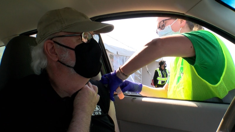 WAVE 3 Photojournalist receives a vaccination shot at Cardinal Stadium