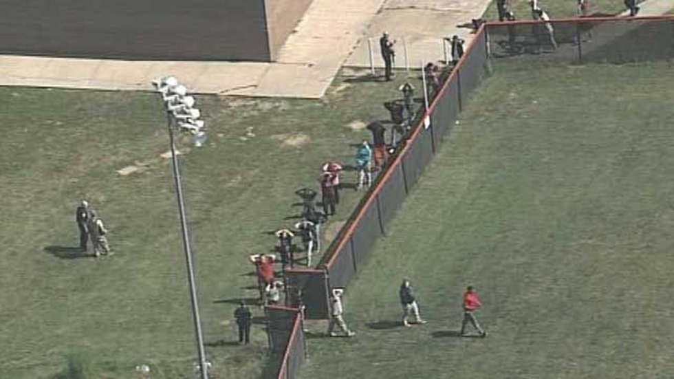 Students could be seen being evacuated with their hands in the air. (Source: Air 3, WAVE 3 News)