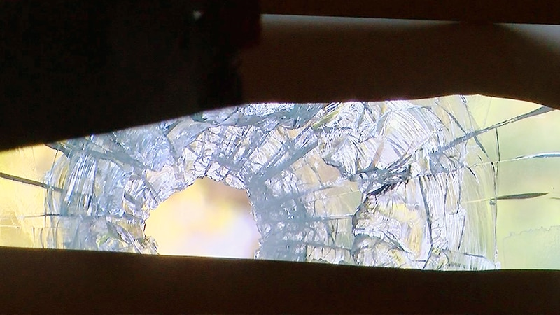 A bullet shattered a window in the Acree's home.