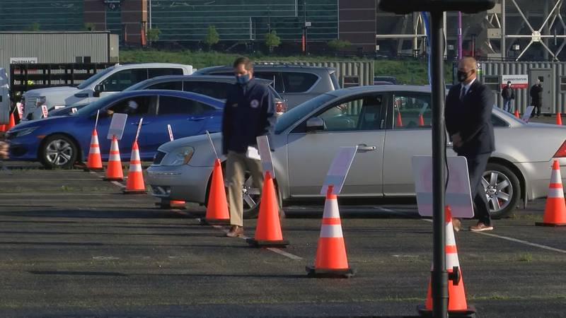 Cars lined up in one of 24 lanes at the University of Louisville's Cardinal Stadium on the...