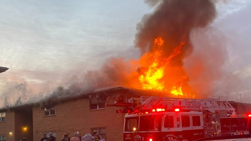 Fire crews worked to extinguish a large apartment complex fire near Clarksville Senior High...