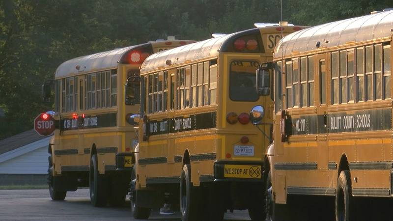 Bullitt County school buses line up outside Hebron Middle School on the first day of class 2021.