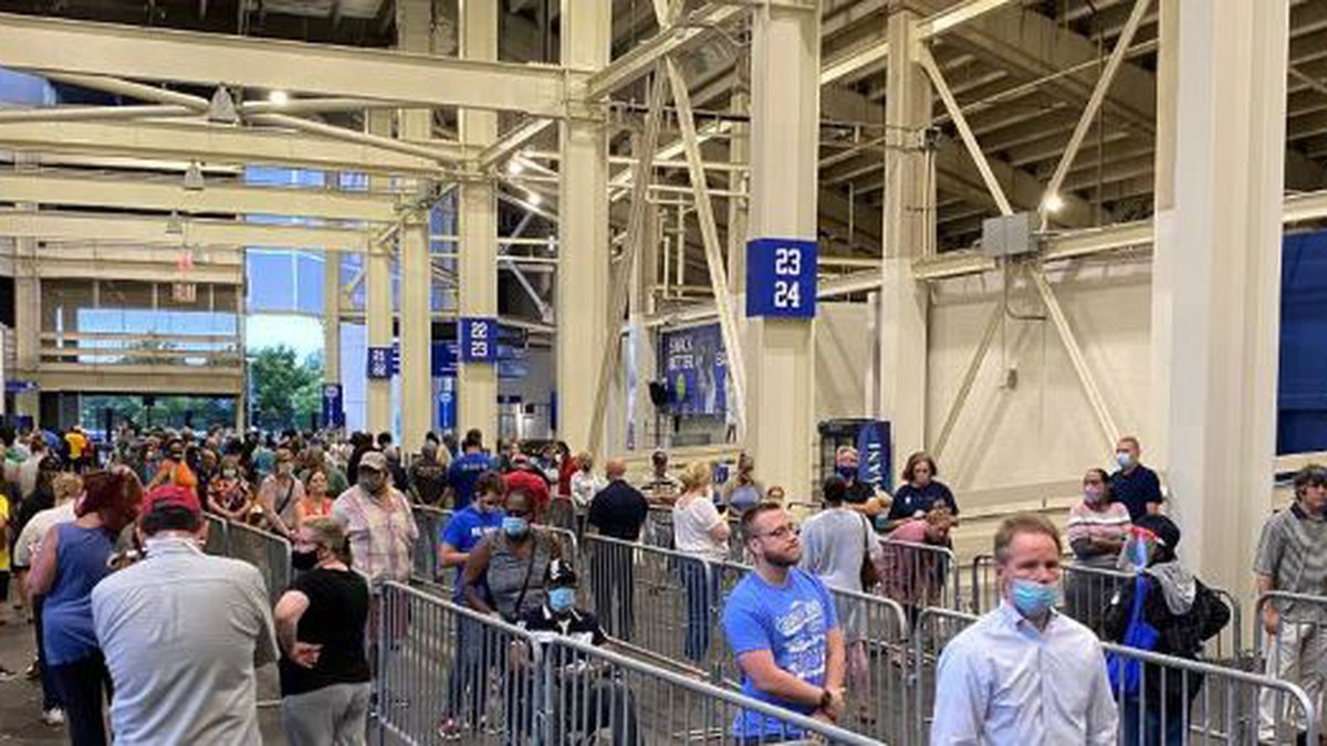 Some people waiting in line to vote in-person at Kroger Field said they'd stood in line for...