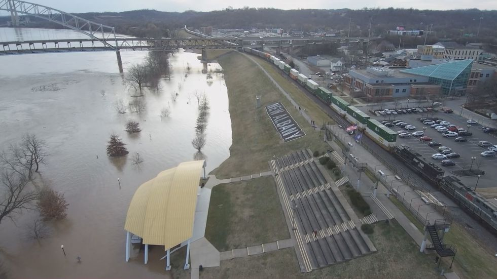 The road at the ampitheatre in New Albany was covered in water following flooding from the Ohio...