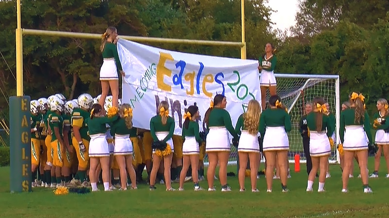 """Eastern High School and North Bullitt High School came together with an """"Eagles United"""" banner,..."""