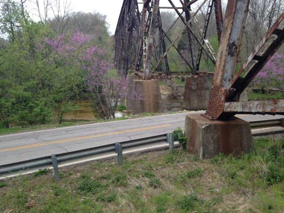 The scene is picturesque underneath an old but very active railroad trestle in the Fisherville...