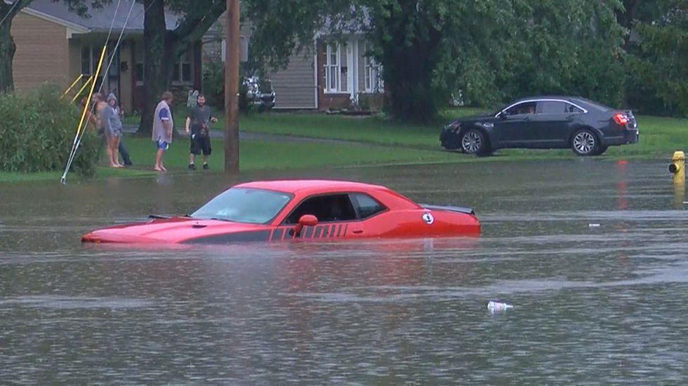 Louisville drivers dealt with heavy rain across the city Friday morning.
